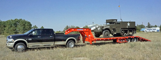 Load-Trail flatbed gooseneck trailer with hydraulic dove tail